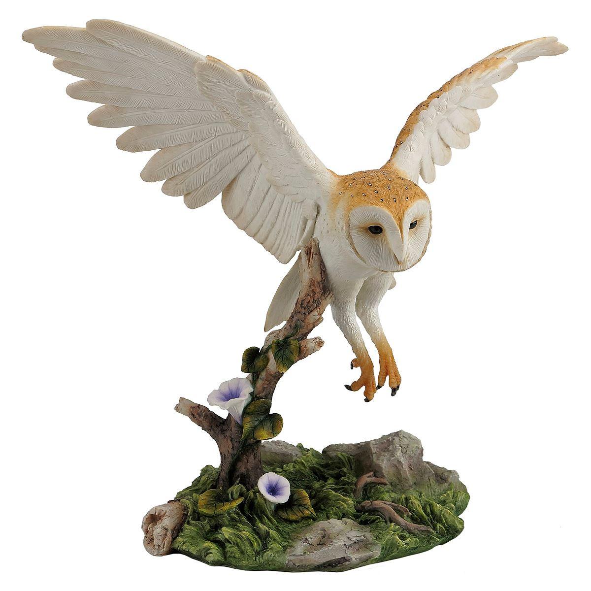 Barn owl flying over branch
